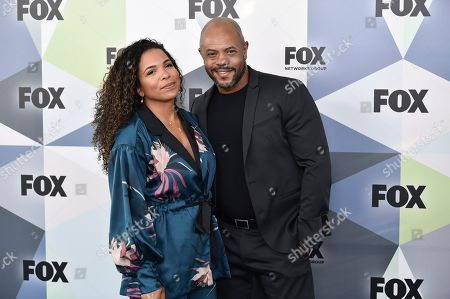 Stock Image of Maya Gilbert, Rockmond Dunbar. Actor Rockmond Dunbar and wife Maya Gilbert attend the Fox Networks Group 2018 programming presentation after party at Wollman Rink in Central Park, in New York