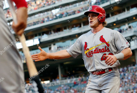St. Louis Cardinals' Harrison Bader is greeted after scoring on a single by Carson Kelly off Minnesota Twins pitcher Jose Berrios during the third inning of a baseball game, in Minneapolis