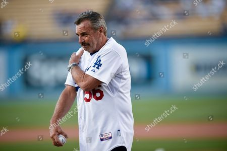 Los Angeles police chief Charlie Beck walks after throwing out the ceremonial first pitch prior to a baseball game between the Los Angeles Dodgers and the Arizona Diamondbacks in Los Angeles