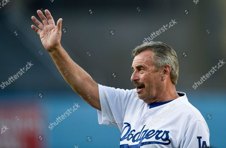 Los Angeles police chief Charlie Beck prepares to throw out the ceremonial first pitch prior to a baseball game between the Los Angeles Dodgers and the Arizona Diamondbacks in Los Angeles