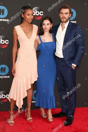 Stock Photo of Fola Evans-Akingbola, Eline Powell, Alex Roe. Fola Evans-Akingbola, from left, Eline Powell and Alex Roe attend the Disney/ABC/Freeform 2018 Upfront Party at Tavern on the Green, in New York