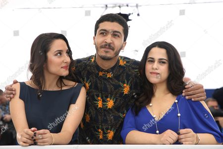 Stock Photo of Sarah Perles, Khafif Hamza, Maha Alemi. Actors Sarah Perles, from left, Khafif Hamza and Maha Alemi pose for photographers during a photo call for the film 'Sofia' at the 71st international film festival, Cannes, southern France