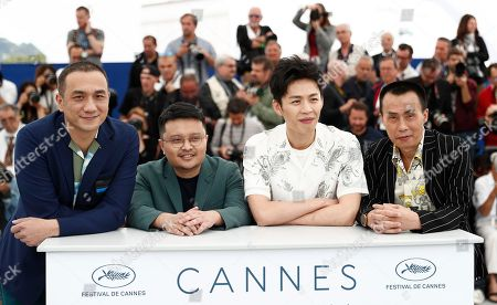 (L-R) Chinese actor Huang Jue, Chinese director Bi Gan, Chinese actor Lee Hong-Chi and Chinese actor Chen Yongzhong pose during the photocall for 'Long Day's Journey Into Night (Di Qiu Zui Hou De Ye Wan)' at the 71st annual Cannes Film Festival, in Cannes, France, 15 May 2018. The movie is presented in the section Un Certain Regard of the festival which runs from 08 to 19 May.