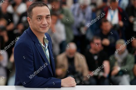 Chinese actor Huang Jue poses during the photocall for 'Long Day's Journey Into Night (Di Qiu Zui Hou De Ye Wan)' at the 71st annual Cannes Film Festival, in Cannes, France, 15 May 2018. The movie is presented in the section Un Certain Regard of the festival which runs from 08 to 19 May.