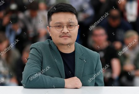 Chinese director Bi Gan poses during the photocall for 'Long Day's Journey Into Night (Di Qiu Zui Hou De Ye Wan)' at the 71st annual Cannes Film Festival, in Cannes, France, 15 May 2018. The movie is presented in the section Un Certain Regard of the festival which runs from 08 to 19 May.