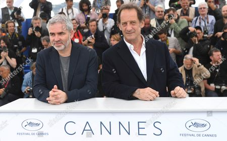 Stephane Brize, Vincent Lindon. Director Stephane Brize, left, and actor Vincent Lindon pose for photographers during a photo call for the film 'At War' at the 71st international film festival, Cannes, southern France