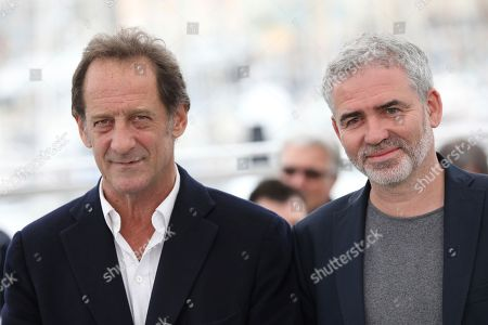 Vincent Lindon, Stephane Brize. Actor Vincent Lindon, left, and director Stephane Brize pose for photographers during a photo call for the film 'At War' at the 71st international film festival, Cannes, southern France