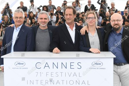 Jean Grosset, Stephane Brize, Vincent Lindon, Melanie Rover, Olivier Lemaire. Jean Grosset, from left, director Stephane Brize, actor Vincent Lindon, Melanie Rover, and Olivier Lemaire pose for photographers during a photo call for the film 'At War' at the 71st international film festival, Cannes, southern France