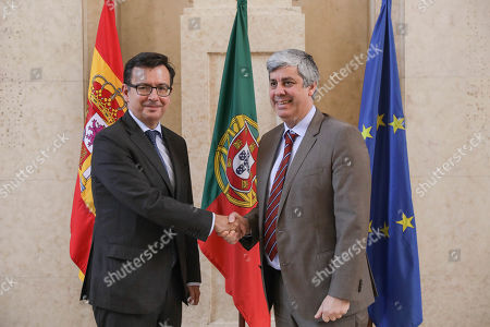 Spain's Economy Minister Roman Escolano (L) is welcomed by Eurogroup President and Portugal's Finance Minister Mario Centeno (R) before a meeting at Portugal's Finance Ministry in Lisbon, Portugal, 16 May 2018.