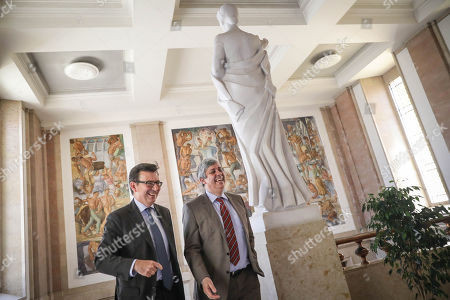 Spain's Economy Minister Roman Escolano (L) accompanied by Eurogroup President and Portugal's Finance Minister Mario Centeno (R) before a meeting at Portugal's Finance Ministry in Lisbon, Portugal, 16 May 2018.
