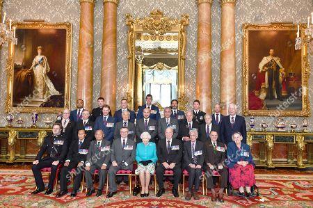A group photo of holders of the Victoria and George Cross medals, (back row left to right) Sgt Johnson Beharry VC, Cpl Joshua Leakey VC, Mr Chris Finney GV, Mr Ben Roberts-Smith VC, Mr Willie Apiata VC, Capt Samuel Shephard GC, Cpl Mark Donaldson VC, WO1 Kim Hughes GC, (middle row left to right) H. E. Mr Norman Hamilton, Malta GC, Mr Barry Johnson GC, Mr Daniel Keighran VC, Mr James Beaton GC, L/Cpl Matt Croucher GC, Mr Dominic Troulan GC, Mr Alf Lowe GC, Mr Jack Bamford GC, Mr Brian Rea RUC GC, (front row left to right) Mr William Speakman VC, Mr Awang anak Raweng GC, Capt Rambahadur Limbu VC, Major Peter Norton GC, Queen Elizabeth II, Mr Anthony Gledhill GC, Mr Henry Stevens GC, Mr Keith Payne VC, Mrs Margaret Purves GC, taken at Buckingham Palace