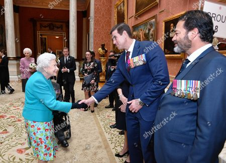 Queen Elizabeth II shakes hands with Mr Ben Roberts-Smith VC at a reception for the living recipients of the Victoria and George Cross medals, in the Picture Gallery at Buckingham Palace