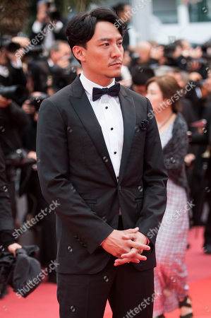 Jury member Chang Chen poses for photographers upon arrival at the premiere of the film 'Burning' at the 71st international film festival, Cannes, southern France