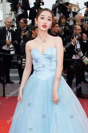 Jiang Mengjie poses for photographers upon arrival at the premiere of the film 'Burning' at the 71st international film festival, Cannes, southern France