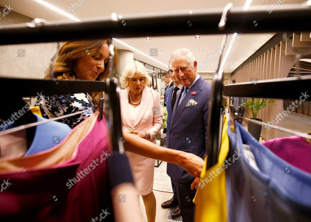 Britain's Prince Charles and Camilla Duchess of Cornwall, tour the new Tech Hub, with Alison Loehnis President of Net-a-Porter, at the Yoox Net-a-Porter Group offices in west London