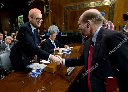 Christopher Wylie shake hands with Sen. Chris Coons D-Del., before he testifies, before the Senate Judiciary Committee on Cambridge Analytica at Capitol Hill, in Washington