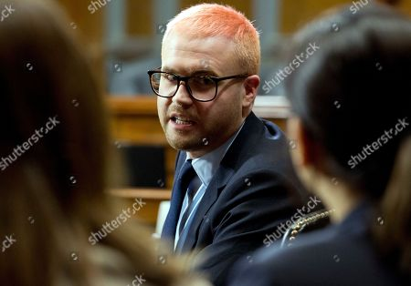 Christopher Wylie speaks with his lawyers during a hearing before the Senate Judiciary Committee on Cambridge Analytica at Capitol Hill, in Washington