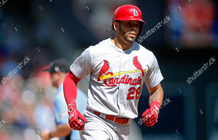 St. Louis Cardinals' Tommy Pham rounds the bases after hitting a solo home run off Minnesota Twins pitcher Phil Hughes in the eighth inning of a baseball game, in Minneapolis. The Cardinals won 7-5