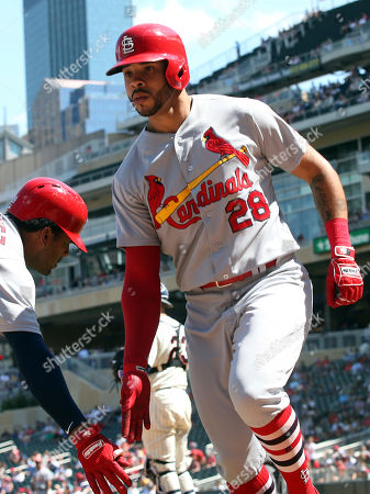 St. Louis Cardinals' Tommy Pham, right, is congratulated after his solo home run off Minnesota Twins pitcher Phil Hughes in the eighth inning of a baseball game, in Minneapolis. The Cardinals won 7-5