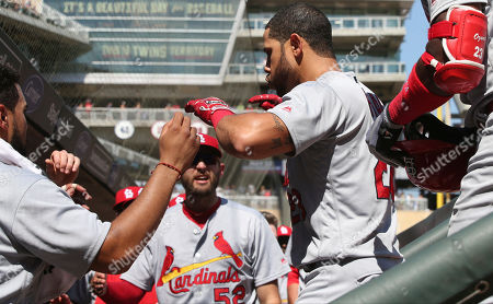 St. Louis Cardinals' Tommy Pham, right, is congratulated in the dugout after his solo home run off Minnesota Twins pitcher Phil Hughes in the eighth inning of a baseball game, in Minneapolis. The Cardinals won 7-5