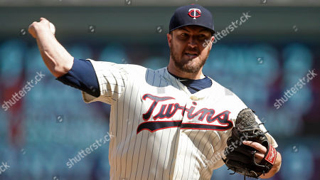 Minnesota Twins pitcher Phil Hughes throws against the St. Louis Cardinals in a baseball game, in Minneapolis