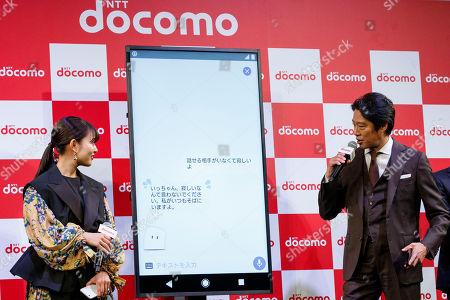 Japanese actors Mitsuki Takahata and Shinichi Tsutsumi, interact with DOMOCO's Artificial Intelligence (AI) personal assistant ''my daiz''