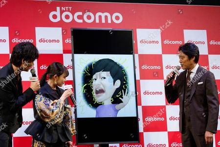 Japanese actors Go Ayano, Mitsuki Takahata and Shinichi Tsutsumi, interact with DOMOCO's Artificial Intelligence (AI) personal assistant ''my daiz''