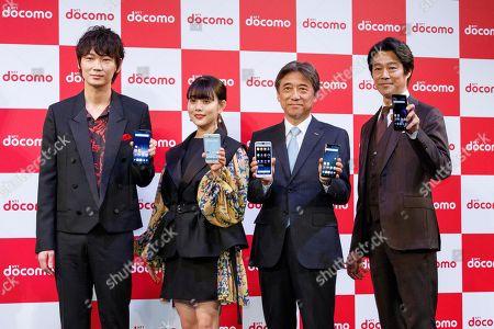 Japanese actors Go Ayano, Mitsuki Takahata, NTT DoCoMo Inc. President and CEO Kazuhiro Yoshizawa and actor Shinichi Tsutsumi