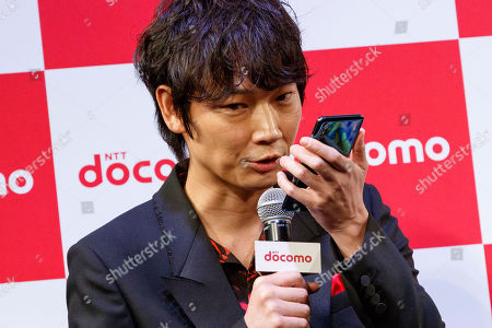 Stock Photo of Japanese actor Go Ayano interacts with DOMOCO's Artificial Intelligence (AI) personal assistant ''my daiz''