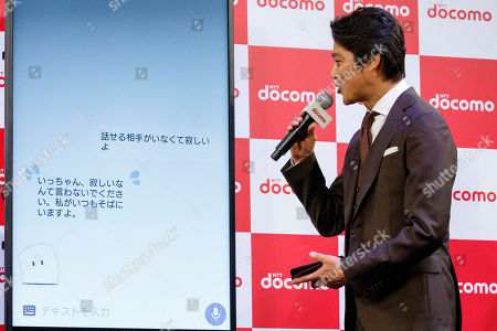 Japanese actor Shinichi Tsutsumi interacts with DOMOCO's Artificial Intelligence (AI) personal assistant ''my daiz''