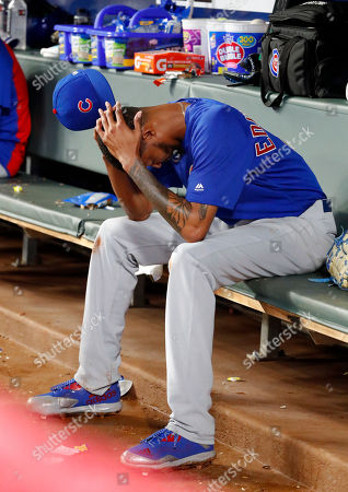 Chicago Cubs relief pitcher Carl Edwards Jr. sits on the bench after being replaced in the eighth inning of the team's baseball game against the Atlanta Braves, in Atlanta. The Braves won 4-1