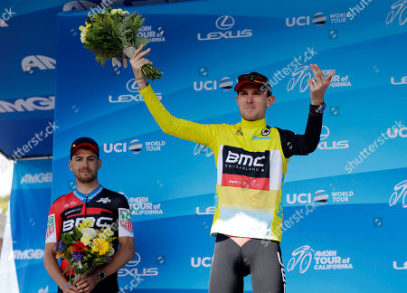 Tejay Van Garderen celebrates on the podium after winning Stage 4, the individual time trial, of the Tour of California cycling race, in Morgan Hill, Calif. At left is Patrick Bevin, of New Zealand