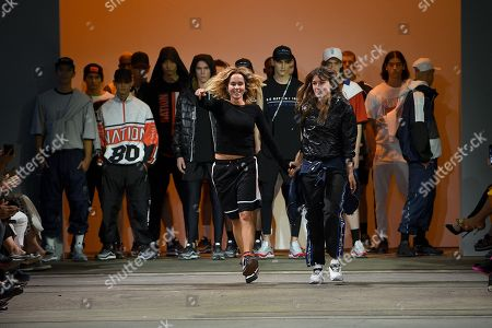 Stock Picture of P.E Nation designers Pip Edwards (L, front) and Claire Tregoning (R, front) gesture during the Active show at the Mercedes-Benz Fashion Week Australia in Sydney, Australia, 17 May 2018.