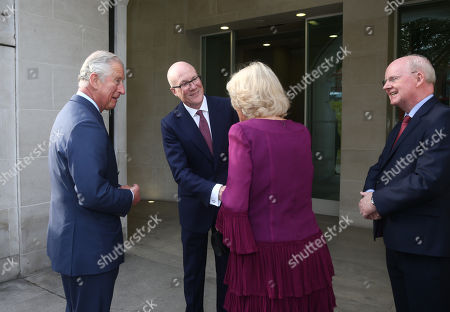 Stock Photo of Prince Charles and Camilla Duchess of Cornwall are greeted by Clive Marshall Chief Executive of the PA Group and Chairman Murdoch MacLennan, as they arrive at the Tate Britain, London, for an event celebrating the 150th anniversary of Press Association.