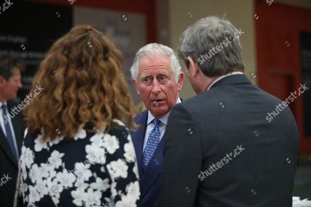 Prince Charles talks with Non-Executive Director Rebekah Brooks and her husband Charlie Brooks, during an event to celebrate the 150th anniversary of the Press Association, at the Tate Britain in London.
