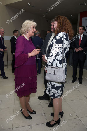 Stock Photo of Camilla Duchess of Cornwall talks with Non-Executive Director Rebekah Brooks, during an event to celebrate the 150th anniversary of the Press Association, at the Tate Britain in London.