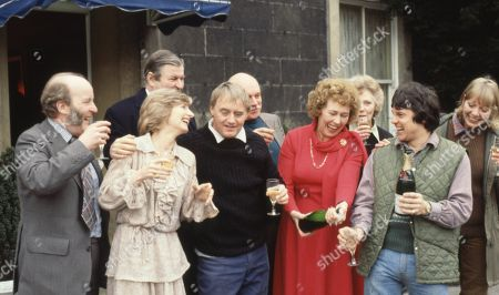 Stock Image of The cast of Emmerdale Farm 1979 celebrate the filming of episode 500 - With Amos Brearly, as played by Ronald Magill ; Rev Donald Hinton, as played by Hugh Manning ; Dolly Acaster, as played by Katharine Barker ; Henry Wilks, as played by Arthur Pentelow ; Matt Skilbeck, as played by Frederick Pyne ; Annie Sugden as played by Sheila Mercier ; Joe Sugden, as played by Frazer Hines ; Kitty Lennard, as played by Katherine Iddon.