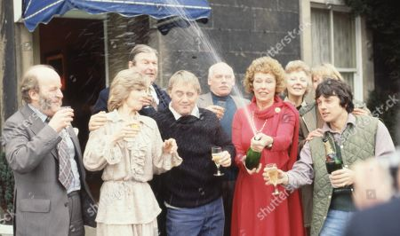 The cast of Emmerdale Farm 1979 celebrate the filming of episode 500 - With Amos Brearly, as played by Ronald Magill ; Rev Donald Hinton, as played by Hugh Manning ; Dolly Acaster, as played by Katharine Barker ; Henry Wilks, as played by Arthur Pentelow ; Matt Skilbeck, as played by Frederick Pyne ; Annie Sugden as played by Sheila Mercier ; Joe Sugden, as played by Frazer Hines ; Kitty Lennard, as played by Katherine Iddon.
