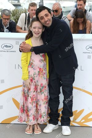 Alida Baldari Calabria, Marcello Fonte. Actors Alida Baldari Calabria, left, and Marcello Fonte pose for photographers during a photo call for the film 'Dogman' at the 71st international film festival, Cannes, southern France