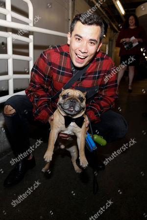 Conrad Ricamora and his dog Wilbur