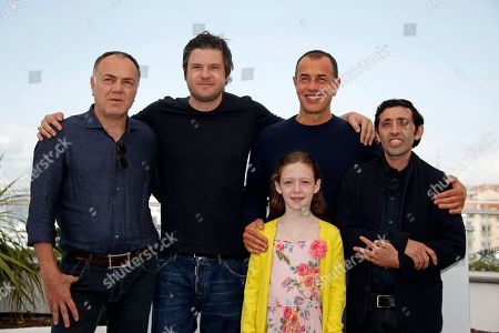 Italian actor Francesco Acquaroli, Italian director Matteo Garrone, Italian actress Alida Baldari Calabria,  Italian actor Macello Fonte, Italian actor Edoardo Pesce pose during the photocall for 'Dogman' at the 71st annual Cannes Film Festival, in Cannes, France, 17 May 2018. The movie is presented in the Official Competition of the festival which runs from 08 to 19 May.