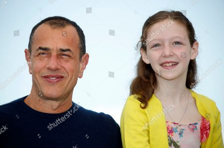 Stock Image of Italian director Matteo Garrone and Italian actress Alida Baldari Calabria poses during the photocall for 'Dogman' at the 71st annual Cannes Film Festival, in Cannes, France, 17 May 2018. The movie is presented in the Official Competition of the festival which runs from 08 to 19 May.