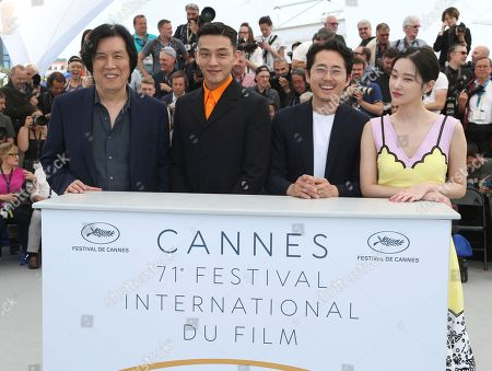 Chang-dong Lee, Ah-in Yoo, Steven Yeun, Jong-seo Jeon. Director Chang-dong Lee, from left, actors Ah-in Yoo, Steven Yeun, and Jong-seo Jeon pose for photographers during a photo call for the film 'Burning' at the 71st international film festival, Cannes, southern France