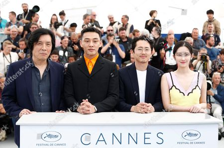 (L-R) South Korean director Lee Chang-Dong, South Korean actor Yoo Ah-In, South Korean actor Yeun Steven and South Korean actress Jun Jong-Seo pose during the photocall for 'Burning' at the 71st annual Cannes Film Festival, in Cannes, France, 17 May 2018. The movie is presented in the Official Competition of the festival which runs from 08 to 19 May.