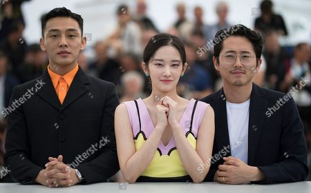 (L-R)  South Korean actor Yoo Ah-In, South Korean actor Yeun Steven and South Korean actress Jun Jong-Seo pose during the photocall for 'Burning' at the 71st annual Cannes Film Festival, in Cannes, France, 17 May 2018. The movie is presented in the Official Competition of the festival which runs from 08 to 19 May.