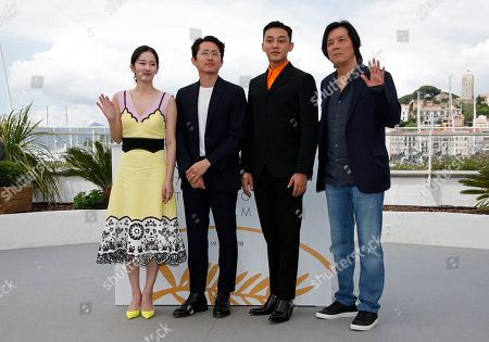 (R-L) South Korean director Lee Chang-Dong, South Korean actor Yoo Ah-In, South Korean actor Yeun Steven and South Korean actress Jun Jong-Seo pose during the photocall for 'Burning' at the 71st annual Cannes Film Festival, in Cannes, France, 17 May 2018. The movie is presented in the Official Competition of the festival which runs from 08 to 19 May.
