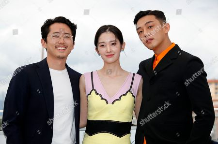 (L-R) South Korean actor Yeun Steven, South Korean actress Jun Jong-Seo and South Korean actor Yoo Ah-In poses during the photocall for 'Burning' at the 71st annual Cannes Film Festival, in Cannes, France, 17 May 2018. The movie is presented in the Official Competition of the festival which runs from 08 to 19 May.