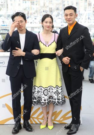 Steven Yeun, Jong-seo Jeon, Ah-in Yoo. Actors Steven Yeun, from left, Jong-seo Jeon, and Ah-in Yoo pose for photographers during a photo call for the film 'Burning' at the 71st international film festival, Cannes, southern France