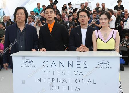 Chang-dong Lee, Ah-in Yoo, Steven Yeun, Jong-seo Jeon. Director Chang-dong Lee, from left, actors Steven Yeun, Ah-in Yoo, Steven Yeun, and Jong-seo Jeon pose for photographers during a photo call for the film 'Burning' at the 71st international film festival, Cannes, southern France