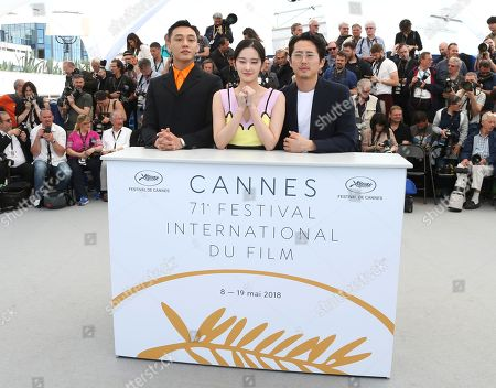 Ah-in Yoo, Jong-seo Jeon, Steven Yeun. Actors Ah-in Yoo, from left, Jong-seo Jeon, and Steven Yeun pose for photographers during a photo call for the film 'Burning' at the 71st international film festival, Cannes, southern France